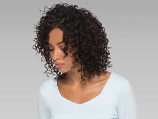 Supercuts model with curly hair