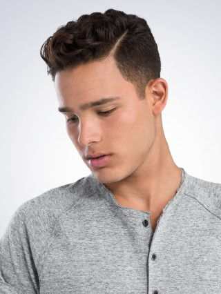 wavy pompadour with part haircut
